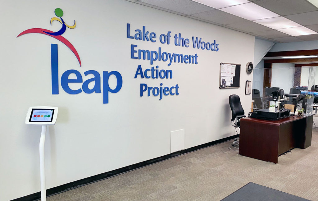 LEAP's office, with reception desk and large graphic on the wall.